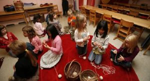 VANCOUVER, BC (October 24, 2006): Grade One students learn to knit during a hand-working class at the Vancouver Waldorf School in North Vancouver, BC. Miss. Glick, the teacher, hand-dyed the wool with vegetables and also owns the sheep from which the wool was produced. (Photo by Deddeda Stemler)