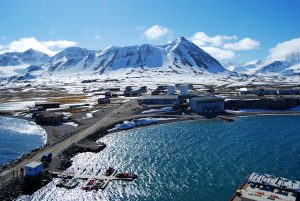 Ny-Ålesund is one of the four permanent settlements on the island of Spitsbergen in the Svalbard archipelago. It is one of the world's northernmost functional public settlement at 78°55′N 11°56′E inhabited by a permanent population of approximately 30–35 scientists and support staff