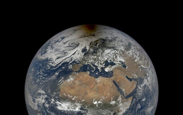 NASA shares image of the moon's shadow over the Arctic